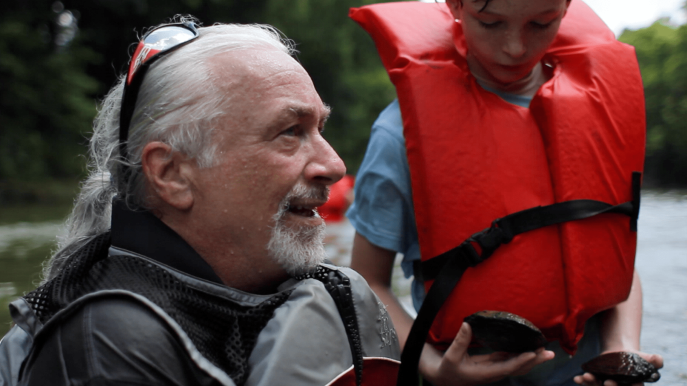 – Elder camper interviewed in a river by youth for The Generation Connection documentary