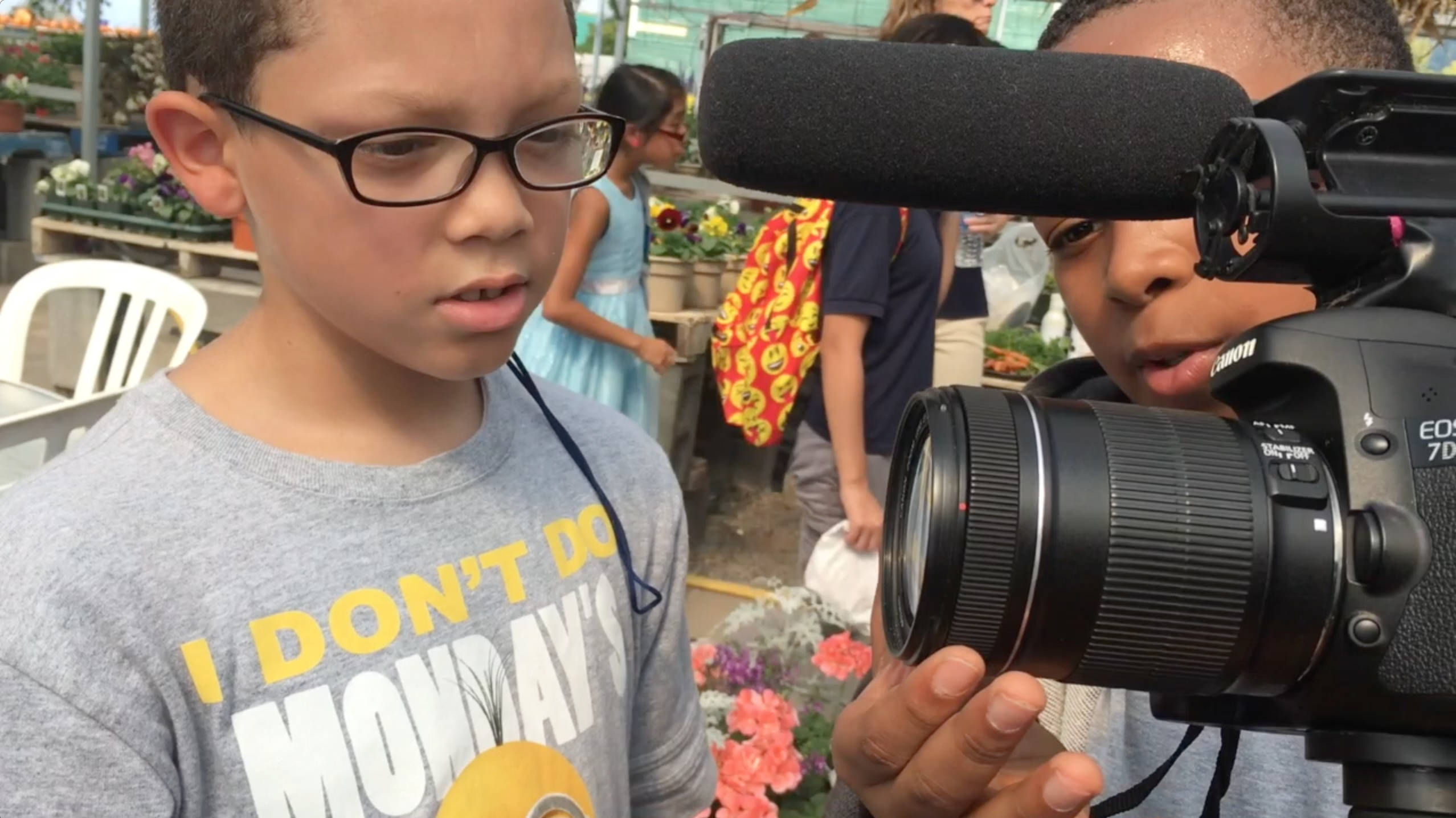 students inspecting camera